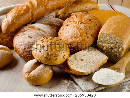 Fresh healthy natural bread on a  wooden table. Selective focus - stock photo
