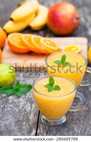 fresh healthy pulpy juice with orange fruits and vegetables - stock photo