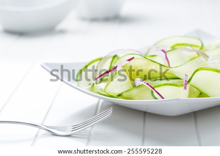 fresh healthy salad of cucumber - stock photo