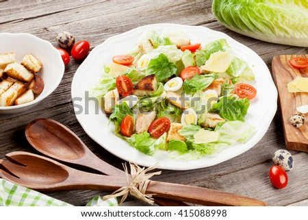 Fresh healthy salad on wooden table - stock photo