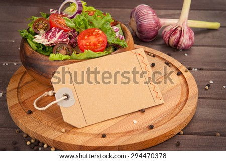 Fresh healthy salad on wooden table close up