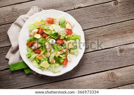 Fresh healthy salad on wooden table. Top view with copy space - stock photo