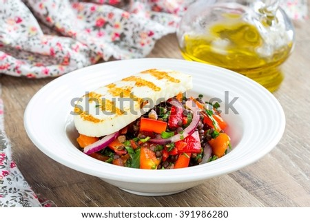 Fresh healthy salad with tomatoes, lentils, grilled cheese, summer homemade dish - stock photo