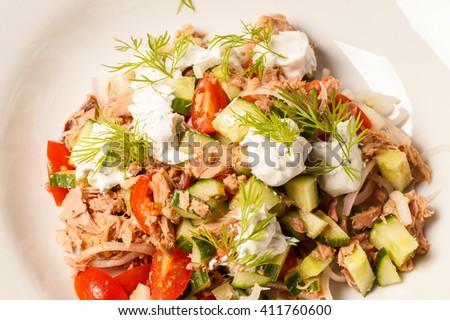 Fresh healthy Tuna salad with dill dressing - stock photo