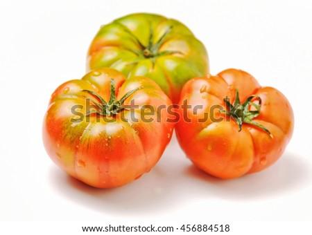 Fresh heirloom tomatoes on white background - stock photo