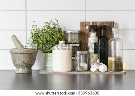 Fresh herbs and spices in clean, modern kitchen - stock photo
