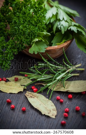 Fresh herbs and spices on wooden table - stock photo