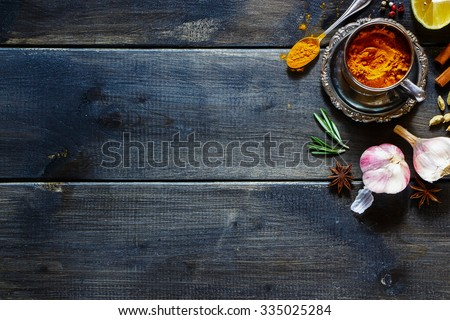 Fresh herbs and spices selection over old wood. Turmeric in a vintage cup on dark vintage background with space for text. Top view. - stock photo