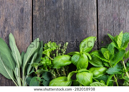 Fresh herbs from garden , on wooden rustic background - stock photo