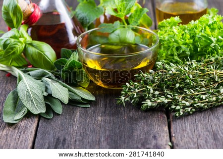 Fresh herbs from garden with olive oil, seasoning background - stock photo