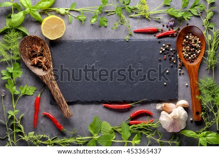 Fresh herbs on stone background