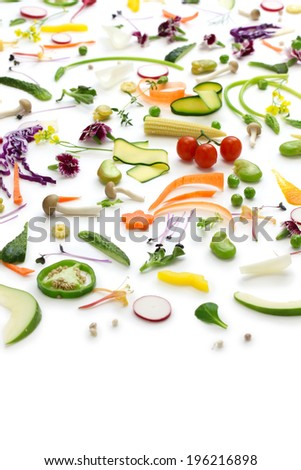 fresh herbs, vegetables and edible flowers collection, healthy salad preparation - stock photo