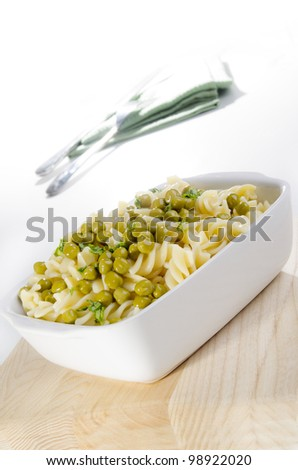 fresh home made pasta salad with sweet peas - stock photo