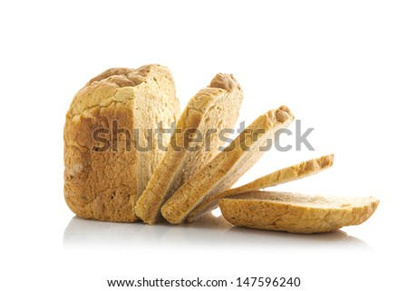 Fresh home-made whole wheat bread, Sliced on white background - stock photo