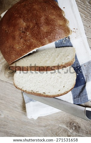 Fresh home village bread on white towel
