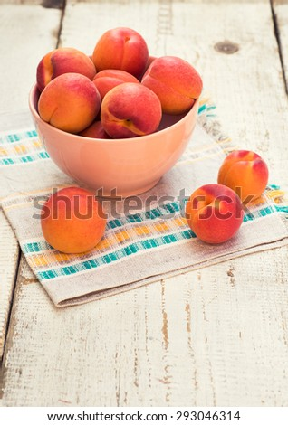 Fresh homegrown apricots on vintage white wooden table