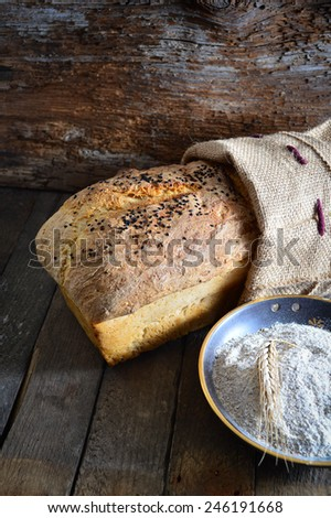 Fresh homemade bread and wheat on the wooden