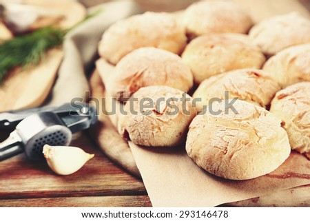 Fresh homemade bread buns on table, close-up - stock photo