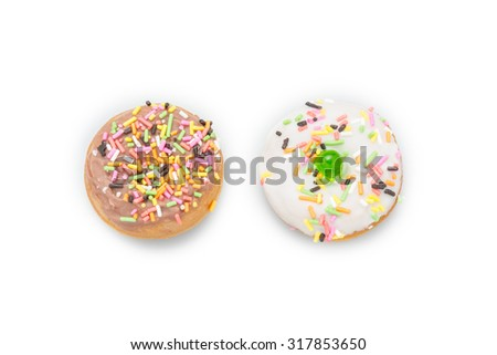 Fresh homemade colorful donuts with icing glaze delicious on white background - stock photo