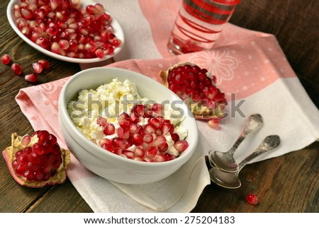 Fresh homemade cottage cheese with pomegranate for breakfast