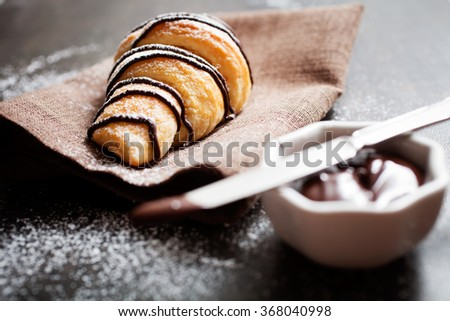 Fresh homemade croissants with chocolate - stock photo