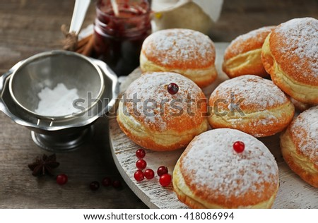Fresh homemade donuts with powdered sugar, close up - stock photo