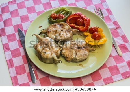 Fresh homemade fried piece of fish served with grilled vegetables.