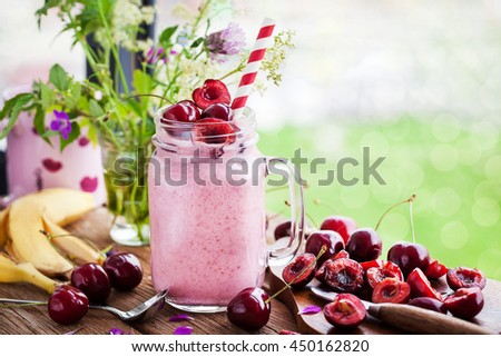 Fresh homemade healthy berry smoothie in mason jar on window background