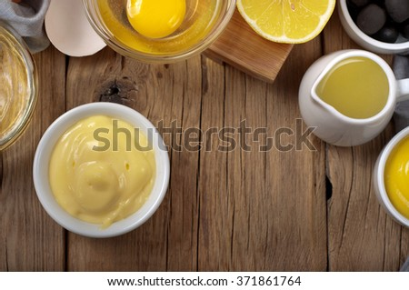 Fresh homemade mayonnaise with ingredients for making mayonnaise. Top view with copy space - stock photo