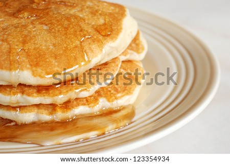 Fresh homemade pancakes with syrup.  Macro with shallow dof. - stock photo