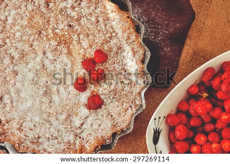Fresh homemade pastries, charlotte with strawberries sprinkled with icing sugar, tasty and easy to prepare lesert - stock photo