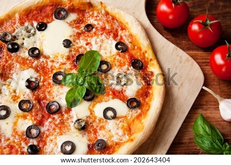 Fresh Homemade Pizza Margherita with Olives and Basil - stock photo