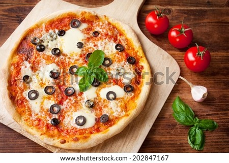 Fresh Homemade Pizza Margherita with Olives, Mozzarella and Basil