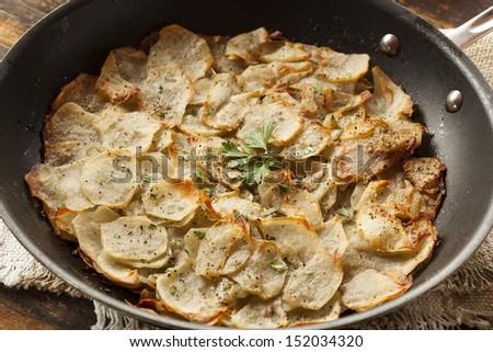 Fresh Homemade Potatoes Anna with Green Parsley - stock photo