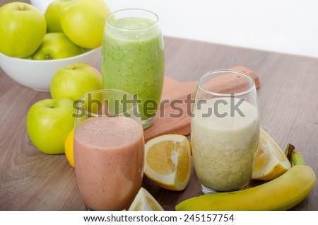 Fresh homemade smoothie - grapefruit, banana and herb - stock photo