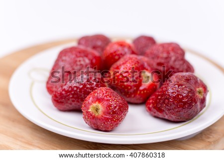 Fresh homemade strawberry on a plate. - stock photo
