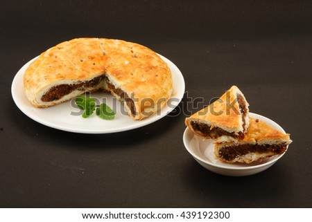 Fresh Homemade Sweet bread stuffed with raisins and coconut - stock photo
