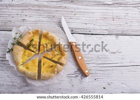 Fresh homemade tart with three kinds of cheese and crispy puff pastry. The concept of simple snacks for healthy homemade food. selective focus - stock photo