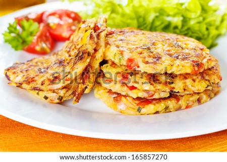 fresh homemade vegetable fritters with zucchini, paprika and corn - stock photo