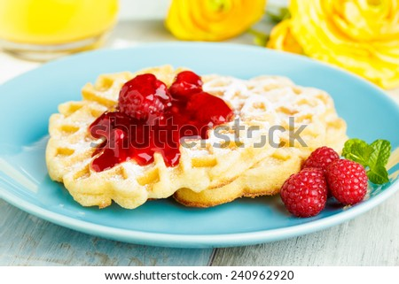 fresh homemade waffles with red fruit jelly and powdered sugar - stock photo