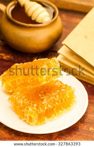 fresh honey and drizzler on a wooden background. Autumn style, honeycomb