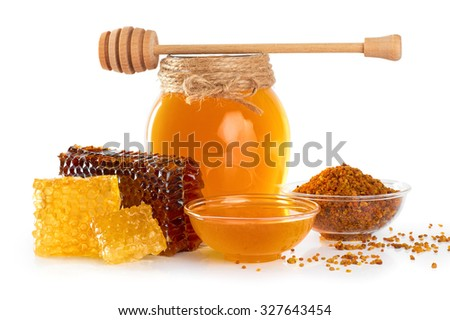 Fresh honey with honeycomb and pollen isolated on white background. Honey dipper. - stock photo
