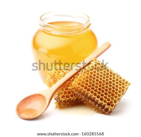 Fresh honey with honeycombs - stock photo