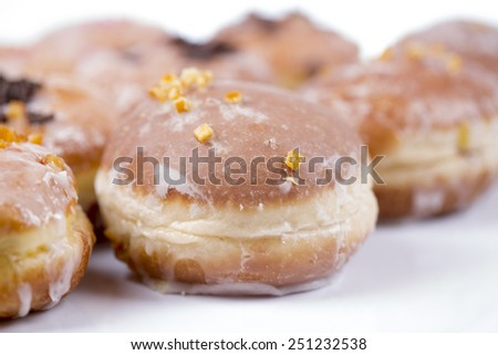 Fresh hot polish donuts with chocolate, jam and icing isolated on white background - stock photo