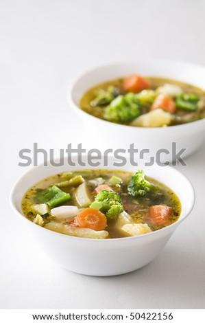 Fresh hot vegetable soup close up shoot - stock photo