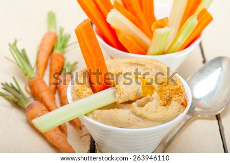 fresh hummus dip with raw carrot and celery arab middle eastent healthy food  - stock photo