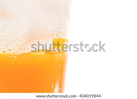 fresh, ice cold carbonated water in glass on white background