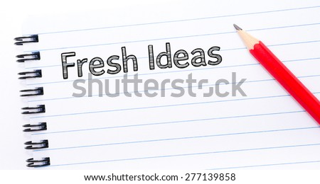 Fresh Ideas Text written on notebook page, red pencil on the right. Concept image - stock photo