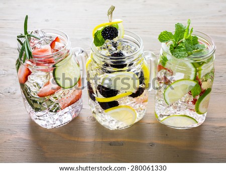 Fresh infused water made with organic ccitruses and berries. - stock photo