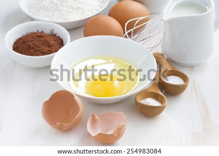 fresh ingredients for baking on a white table, close-up, top view - stock photo